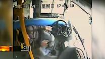 Bus driver in China has near-death close call