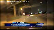 Woman strikes median during police chase