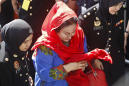 Wife of ex-Malaysia PM questioned, new graft scandal unfolds