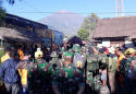 The Latest: Strong quake cuts power across Indonesian island