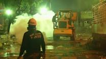 Thai protesters battle into the night using bulldozer
