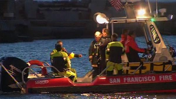 Divers recover body after van drives into bay
