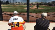 Does this Nolan Ryan fan know who's sitting next to him?