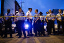 The Latest: Philly police: Gunman had AR-15, handgun