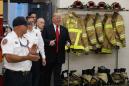 The Latest: Trump meets firefighters, touts tax bill