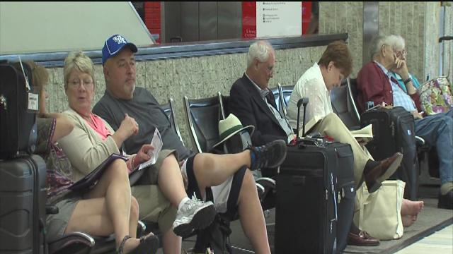 Flight delays pile up after FAA cuts