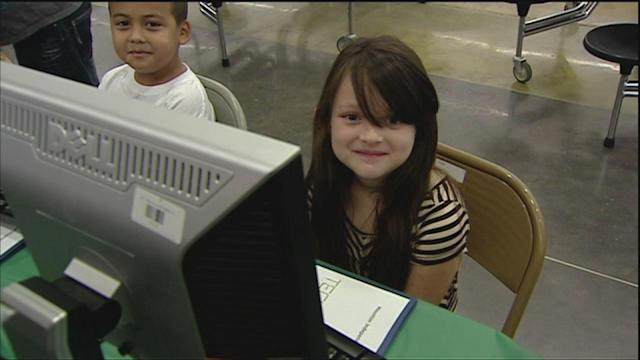Dozens of HISD 1st graders getting free computers