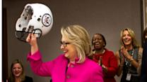 Staffers cheer as Clinton returns to work
