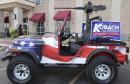 After balking, Kansas parade won't bar Kobach's replica gun