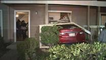 Alleged hit-and-run driver crashes into apartment