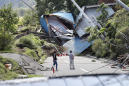 The Latest: 4 dead, over 30 buried in northern Japan quake