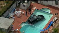 Raw: SUV Plunges Into Pool