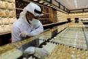 Gold hits two-week low on optimism around reopening of economies