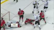 Hossa cleans up Toews stickhandling effort