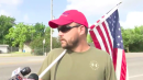 Man shows up to site of Santa Fe High School shooting with American flag, Trump hat and gun