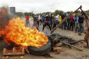 The Latest: Zimbabwe charges labor leader with subversion