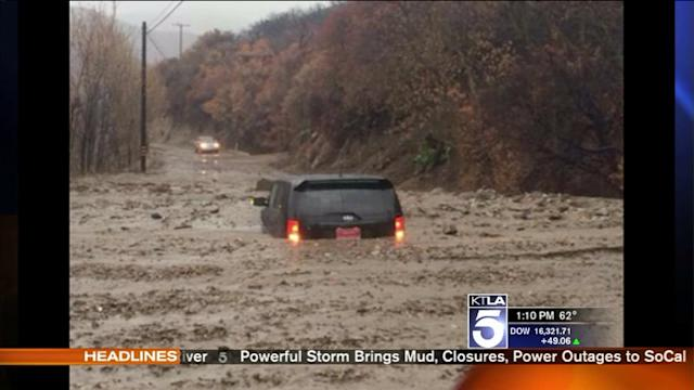 Woman Escapes Just Before SUV Surrounded by Mud