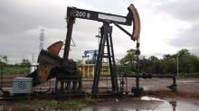 Oil down as Iraq says no cuts; Wall St, Cushing draw limit loss