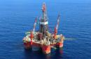 Oil prices skid 2%, extending slide as China virus spreads