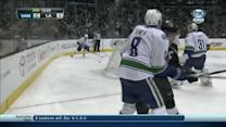 Dustin Brown flattens Tanev with a heavy hit