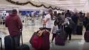 Rain and fog delay last-minute holiday travelers