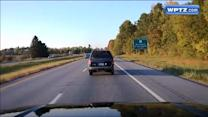 Dashcam records motorcyclist doing wheelies