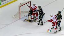 Abdelkader deflects Lashoff's shot by Miller