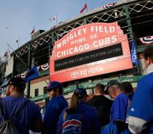 Cubs fan camp outside Wrigley Field hoping for NLCS tickets