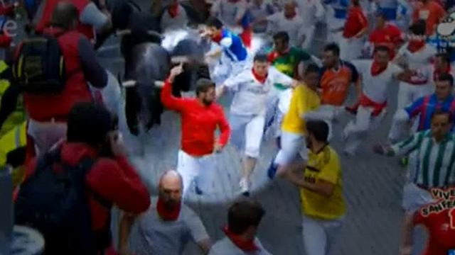 Spanish police seek man who took selfie during bull run