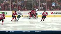 Zach Parise deflects puck past Cory Schneider