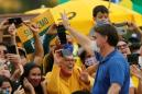 Bolsonaro snaps photos with children at Brazil protest, defying health advice