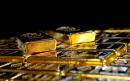 Gold slips as dollar firms after Trump, Biden face off