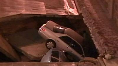 Sinkhole Swallows Two Vehicles