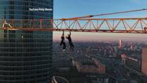 Daredevils Perform Dangerous Stunt from Crane in Moscow