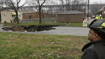 Raw: Storm Rips Open Chicago Sinkhole