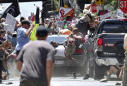Photographer captures moment car slammed into counterprotesters in Charlottesville. It was his last day on the job.
