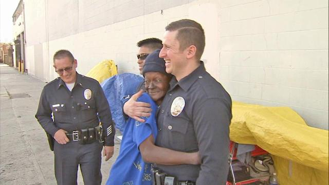 LAPD officers pull Skid Row homeless woman from burning tent