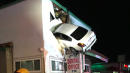 Car Flies Into Second Floor Of Building And Stays There
