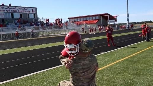 Dad's Homecoming Overwhelms Footballer Son