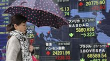 Asian shares dip as Fed minutes show rate hike expected soon