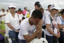 The Latest: Colombian leader promises pope to take in exiles