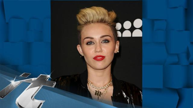 Pop Music News Pop: Miley Cyrus Flashes Leggy Look in Short Shorts, Sends Message With Jacket