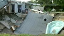 Families Frantically Run for Safety After Sinkhole Swallows Home